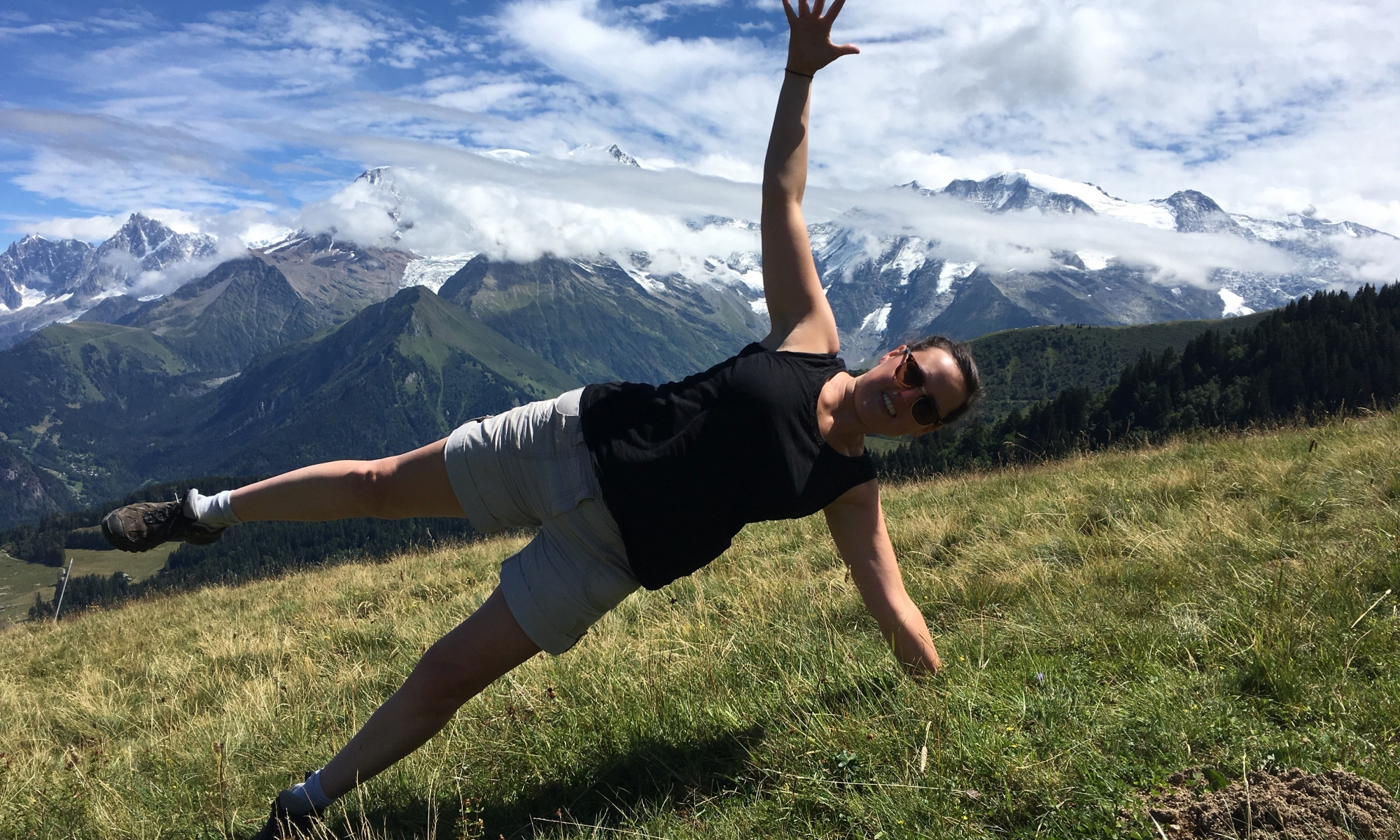 Woman doing Pilates in mountains